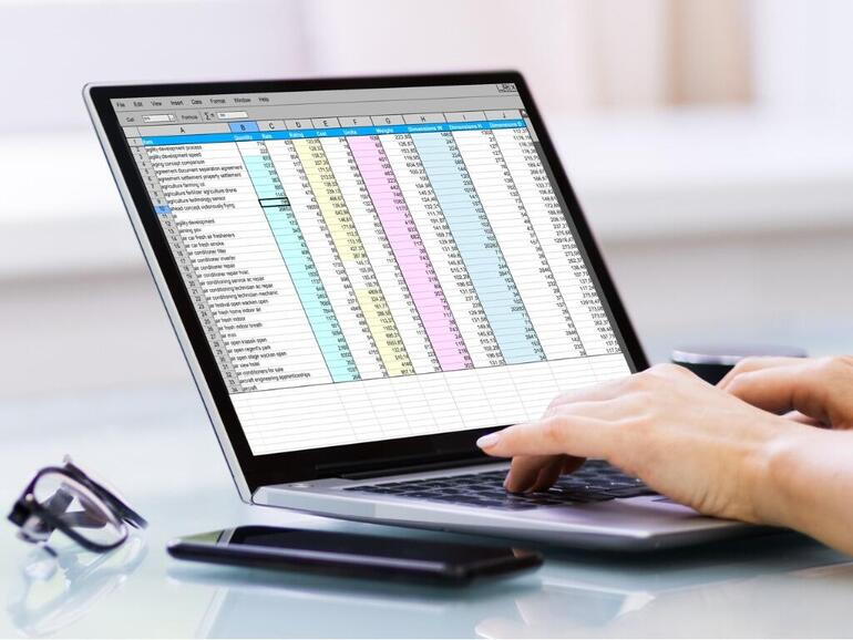analyst-woman-working-with-spreadsheet-report-software-picture-id1249379723.jpg